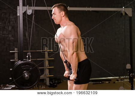 man with weight training in gym equipment sport club fitness and bodybuilding.