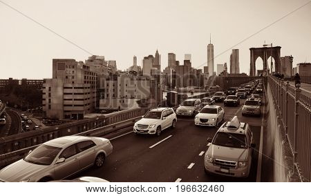 Rush hour traffic in downtown Manhattan with Brooklyn Bridge in New York City
