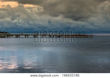 wooden pier in the sunset Baltic sea. Chalupy beach Poland  Europe .