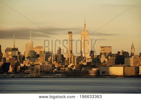 New York City midtown skyline with skyscrapers over Hudson River viewed from New Jersey
