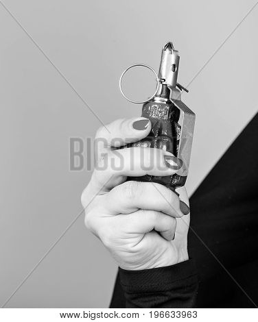 A hand holds a grenade, black and white photo