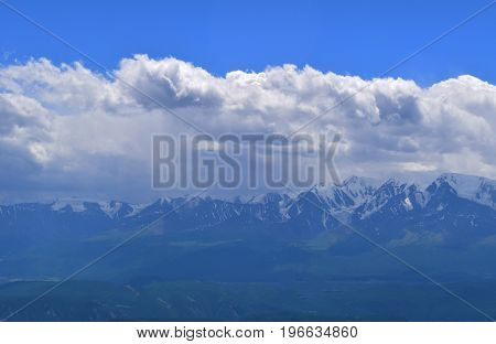 Lanscape of North-Chuyski ridge with snow peaks and glacier in overcast and smoke weather. Altai mountains. Aktash Altay Republic Russia.