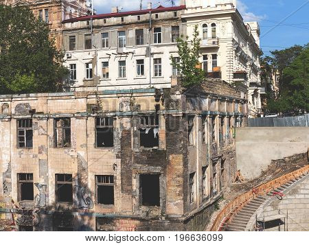 Old Abandoned Buildings In The City Centre, The Era Of The Soviet Period On A Summer Day. Collapsing