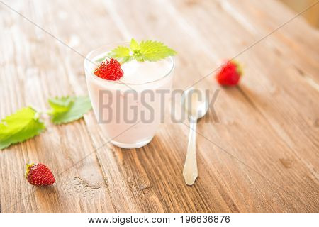 Fresh Strawberry Yoghurt On Rustic Wooden Table