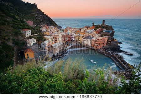 Vernazza bay with buildings on rocks over sea in Cinque Terre, Italy.