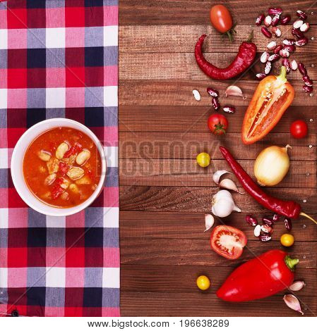 Tom Yum Goong Spicy Sour Soup on wooden table top view Thai local food