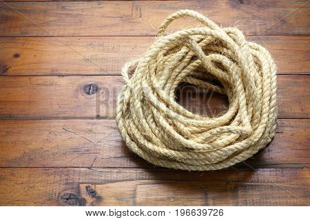 Bundle of Rope on a Wooden Background