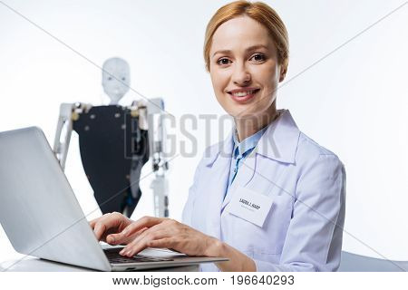 Exploring new technologies. Innovative talented strategic woman working in a lab and using her computer for analyzing obtained data