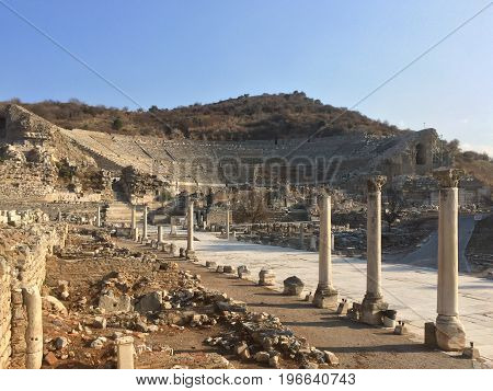 Roman Amphitheater Ruins End To The Main Road With Stone Columns Row In Ephesus Archaeological Site