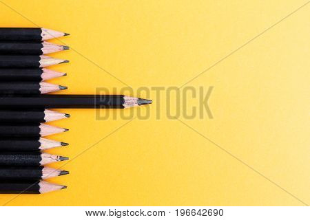 Black Sharp Wooden Pencils in yellow background