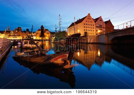 Sunken ship in a bay of Gdansk in summer evening