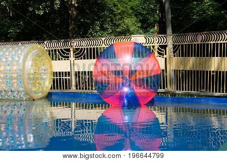 Giant Plastic Zorbing Balloons Floating On Water In Park