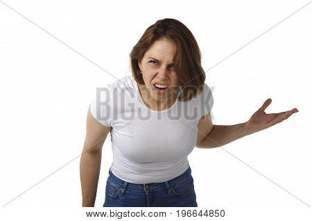 Beautiful young girl on a white background with an emotion of anger shouts