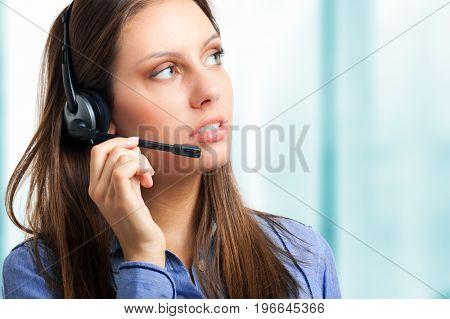 Smiling female call center operator isolated on white