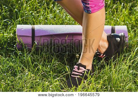 Body Part: Woman In Sport Clothes And Sneakers With A Mat