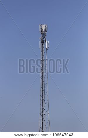 GSM antenna against blue sky.