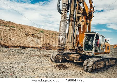 Construction Site, Highway Building With Industrial Rotary Drilling Machinery Making Holes In The Gr