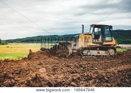 Yellow Mini Bulldozer Leveling Ground Earth For Highway Foundation Site