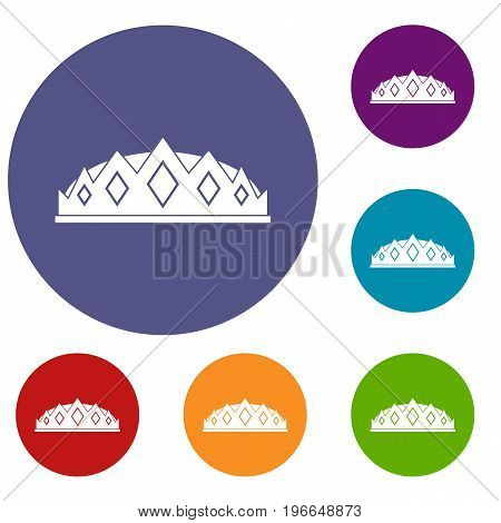 Small crown icons set in flat circle red, blue and green color for web