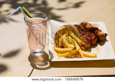 Currywurst and pommes on composable dishes, german food