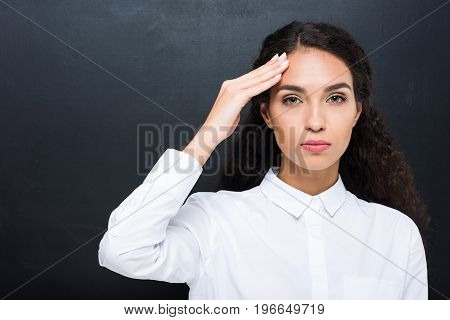 Tired Brunette Woman With Headache In White Shirt Looking At Camera