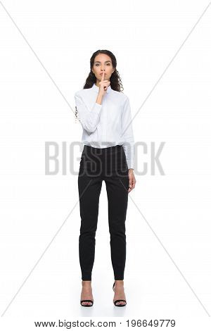 Attractive Brunette Businesswoman In Formalwear Showing Silence Symbol, Isolated On White