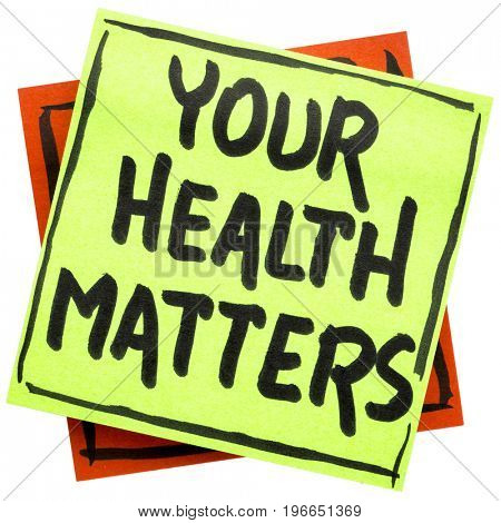 your health matters reminder - handwriting in black ink on an isolated sticky note