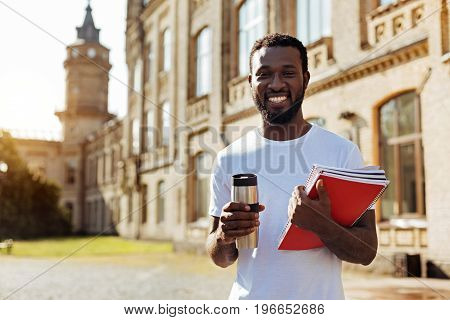 Enthusiastic student. Charming positive nice guy starting another year and attending lectures while brining notes with him