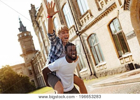 Energetic guys. Energetic eccentric nice guys having fun and running outdoors while enjoying their time at the university