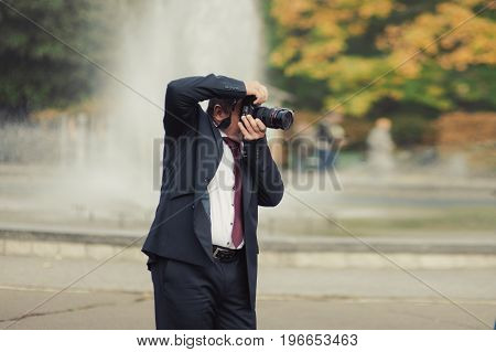 A Man Takes Pictures With A Camera