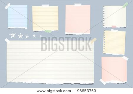 Ripped colorful, pastel note, notebook, copybook strips stuck with sticky tape and stars on blue background
