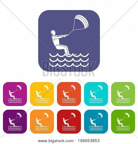 Man takes part at kitesurfing icons set vector illustration in flat style in colors red, blue, green, and other
