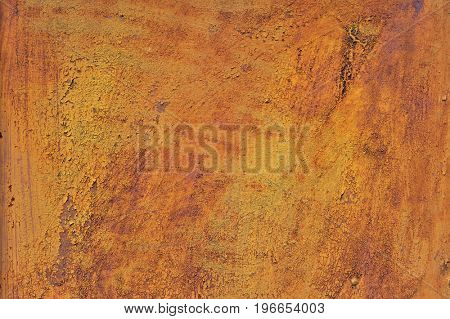 Orange brown old rusted corroded metal or steel sheet horizontal wall background as abstract dirty textured metallic vintage industrial closeup for retro grungy surface design. A rough iron aged plate