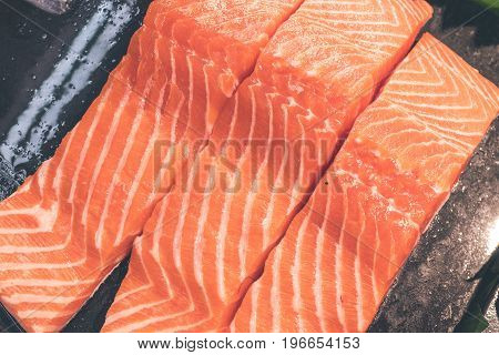 Close up meat texture of raw salmon fillet. Raw salmon atlantic fish on the local food market on Bali island.