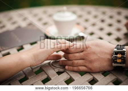 Holding Hands. Closeup View Of Married Couple Holding Hands