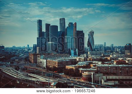 Moscow city modern business center. Panoramic view from high building. Retro style film colors.