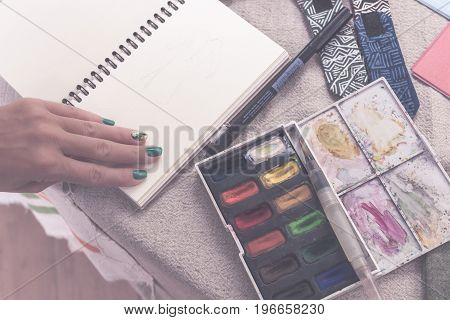 Painting Palette Sketchbook Paper Brushes White Table. Bali.
