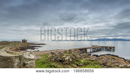 Portencross Bay with the Castle and jetty just before it rained in the late afternoon. Ailsa Craig can be seen in the far distance.
