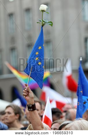 CRACOW POLAND - JULY 23 2017: Another day in Cracow thousands of people protest against violation the constitutional law in Poland. Defense of the triad of division of power free election and independence of the highest court in Poland