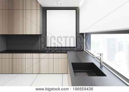 Gray and wooden kitchen interior with a row of countertops and a sink. A framed vertical poster on a wall. 3d rendering mock up