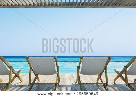 Four white and wooden deck chairs standing on a pier. A beautiful cloudless sky. 3d rendering mock up