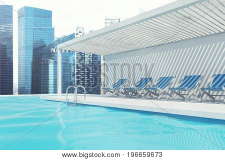 Row of blue deck chairs standing along a swimming pool. A magnificent cityscape in the background. 3d rendering mock up