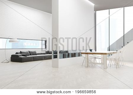 White brick wall living room with a gray sofa and poufs a bookshelf in a white wall. Dining room table a staircase and a panoramic window. 3d rendering mock up