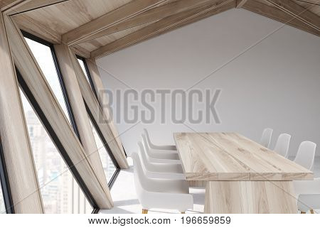 Attic conference room interior with a long wooden table rows of white chairs near it. Wooden ceiling. Close up. Side view. Corner. 3d rendering mock up