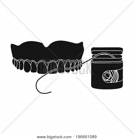 Cleaning the teeth with a Silk dental floss. Stomatology single icon in black style vector symbol stock illustration .