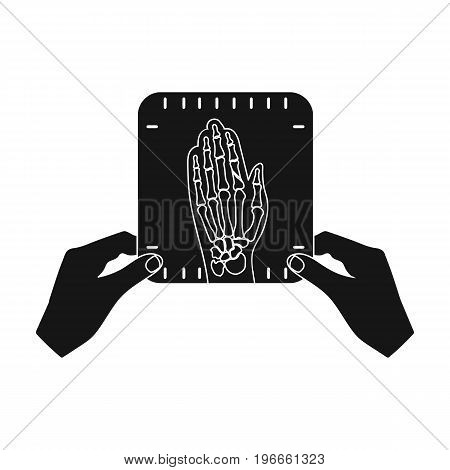 X-ray picture of the hand of a person in the hands of a radiologist. Medicine single icon in black style vector symbol stock illustration .