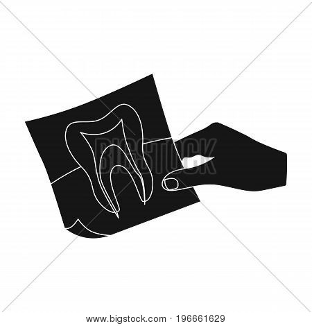 X-ray of the tooth in the hand of the dentist. Stomatology single icon in black style vector symbol stock illustration .
