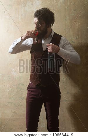 Hipster With Bottle Drinking Red Wine In Glass