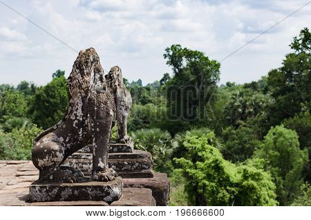 Lions guarding Angkor Wat temple in Cambodia
