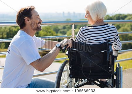 What can I do for you. Enthusiastic devoted kind guy taking senior lady for a walk and entertaining her with stories while working as a volunteer